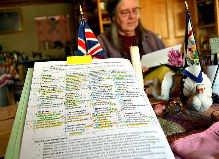 Diane Schou of Green Bank, WV, pictured with her catalogued list of the symptoms of electrosensitivity.